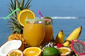 stock photo of fruit-juice  - fruits juice with fruits on bottom tropical lagoon tropical cocktails - JPG