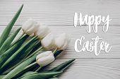 Happy Easter Text Greeting Card Sign On Stylish White Tulips On Rustic Wooden Table Background Top V poster