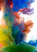 Colors Dropped Into Liquid And Photographed While In Motion. Ink Shape Or Swirling In Water For Desi poster