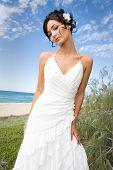 Bride In Wedding Gown On Beach
