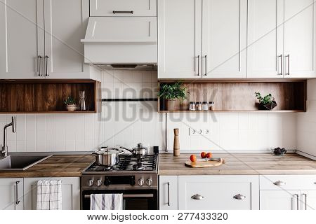 poster of Cooking Food On Modern Kitchen With Furniture In Grey Color And Wooden Tabletop.  Knife On Wooden Cu