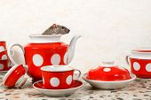 Closeup A Rat (rattus Norvegicus)  Sits And Looks Out From Teapot. Red Tea Set On Countertop At Kitc poster