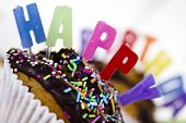 stock photo of happy birthday  - Cupcakes spelling out happy birthday - JPG