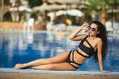 Luxury Travel Bikini Girl Vacation Banner. Asian Woman Sun Tan Over Idyllic Ocean Water In Bora Bora poster
