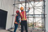 Construction Engineer Teamwork Are Inspection Site Constructing And Installation Steel Scaffolding P poster