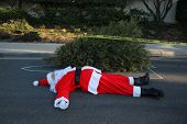 Crime Scene.  Santa Claus lays dead on the ground with a Police Chalk Line and Sheriff Do Not Cross  poster