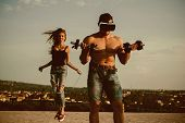 Athletes On Fresh Air. Athletes Training Together. Athlete Man Wear Vr Glasses With Dumbbells While  poster