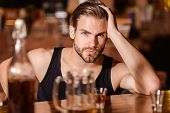 Enjoy The Drinks, But Not Too Much. Alcohol Addiction And Bad Habit. Alcoholic Man Drinking At Bar C poster