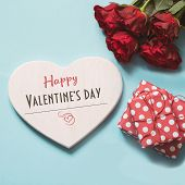 Valentines Card With Space For Text, Bouquet Red Roses, And Giftbox On Blue. Copy Space. View From A poster