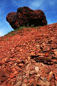 picture of scoria  - Red conglomerate of the waste bank under the blue sky - JPG
