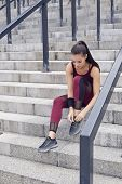 Fitness Sporty Woman During Outdoor Exercises Workout. Beautiful Fit Girl Sitting On Stairs. Fitness poster
