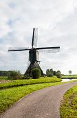 Front View Dutch Windmill In Autumn