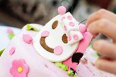 Taking a piece of child's birthday cake