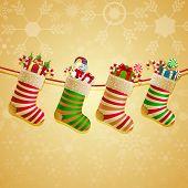 Hanging Christmas Socks With Present.