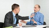 Business People Fighting At The Desk In Office