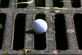 Igolf ball on the grate covering