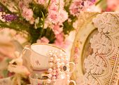Vintage teacups, ballet dancer statuette, frame and flowers