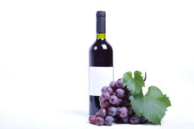 stock photo of wine grapes  - Close up of a bottle of wine and grapes - JPG