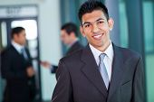 happy modern middle eastern businessman in office