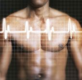 foto of superimpose  - Midsection of shirtless man with electrocardiogram graph superimposed on chest - JPG