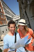 Couple looking at map by the Bridge of Sighs, Venice