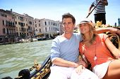 stock photo of gondola  - Couple in Venice having a Gondola ride on canal grande - JPG