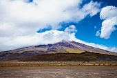 Cotopaxi Volcano In The Background Of Blue Sky And Clouds