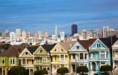 The famous painted ladies house in San Francisco California with skylin