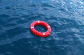 picture of lifeline  - Red lifeline on the sea waiting for help - JPG