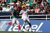 PASADENA, CA - JULY 7: Alberto Quintero #19 of Panama and Israel Jimenez #2 of Mexico during the 201