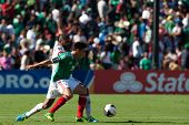 PASADENA, CA - JULY 7: Efrain Velarde #15 of Mexico and Gabriel Gomez #6 of Panama during the 2013 C