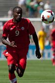PASADENA, CA - JULY 7: Tosaint Ricketts #9 of Canada chases down the ball during the 2013 CONCACAF G