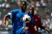 PASADENA, CA - JULY 7: Olivier Thomert #13 of Martinique controls the ball during the 2013 CONCACAF