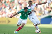 PASADENA, CA - JULY 7: Carlos Pena #6 of Mexico and Gabriel Torres #9 of Panama during the 2013 CONC