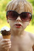 Child With Attitude Eating Ice Cream Cone