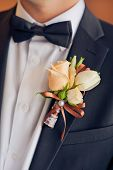 foto of boutonniere  - wedding boutonniere on suit of groom - JPG