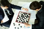 The above view of business partners playing chess, conceptual image
