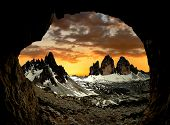 Tre cime di Lavaredo with Paternkofel  at sunset, Dolomite Alps, Italy  View from man-made caves fr