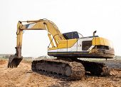 stock photo of backhoe  - Excavator Loader with backhoe standing in sandpit - JPG
