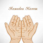 Muslim praying hands concept for Ramadan Kareem.