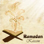 stock photo of muslim  - Holy month of muslim community Ramadan Kareem concept with open islamic religious book Quran Shareef on floral decorated background - JPG