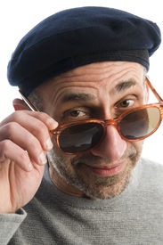stock photo of honkers  - middle age senior man wearing artist french hippie beret hat macro close up distorted large nose face retro sunglasses - JPG