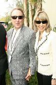 Eric Idle and Tania Kosevich at the ceremony posthumously honoring George Harrison with a star on th