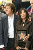 Sir Paul McCartney and Olivia Harrison at the ceremony posthumously honoring George Harrison with a