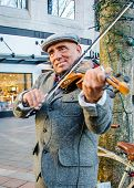 Violinist provides entertainment in Westlake Park in Seattle