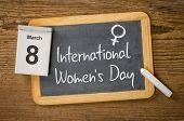 International Women's Day March 8 written on a blackboard
