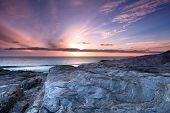 Sunset Over Rocky Beach