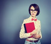 stock photo of clever  - Retro Portrait of Trendy Hipster Girl Wearing Glasses - JPG