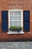 English sash window with storm shutters