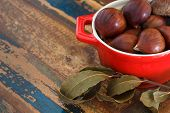 Chestnut And Bay Leaf On Table